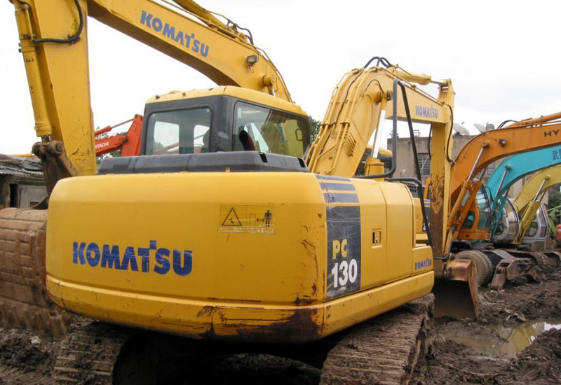 A Komatsu sulks in a used machinery lot.