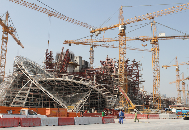 A dozen Liebherr tower cranes are helping to build the National Museum of Qatar.
