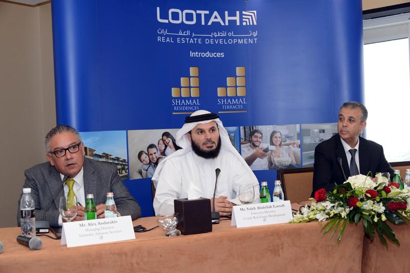 Saleh Abdullah Lootah (centre), executive director of Lootah Real Estate Development, Ahmad Saeed (right), senior director, Arif and Bintoak, Alex And