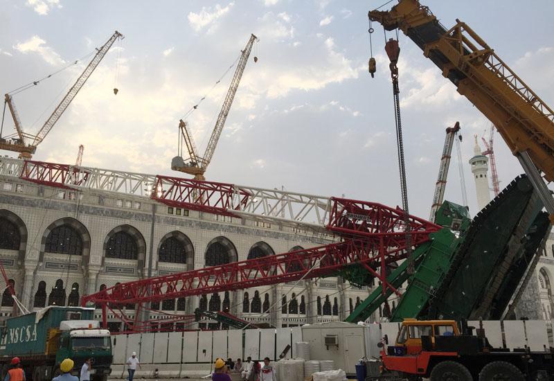 The prone LR 11350 lattice boom crawler crane on site, attended by a Tadano all-terrain crane prepped to assist proceedings.