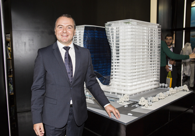 Mark Phoenix with a model of Opus, Omniyat's Zaha Hadid-designed hotel project at Business Bay.