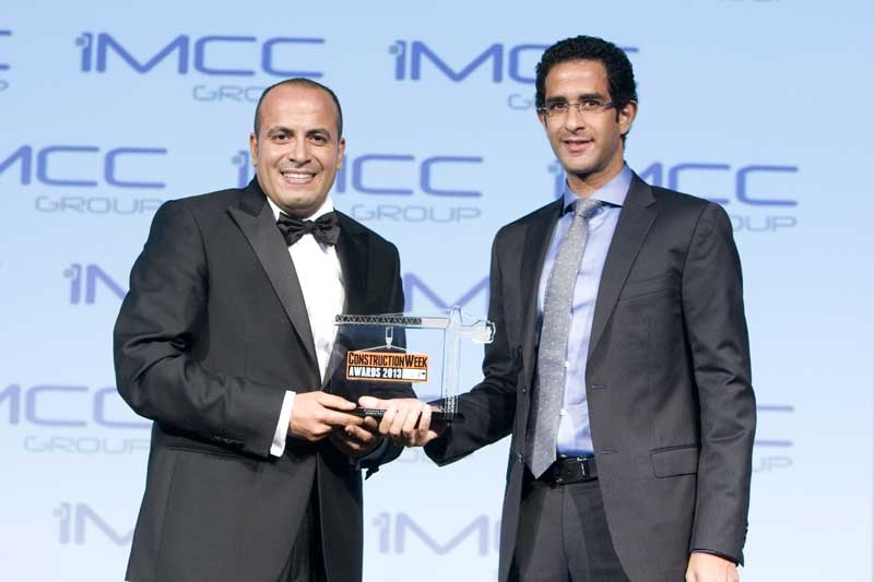 BAM International's Maged Fares (left) receives Project Manager of the Year Award from iMCC Group's Mina Nagib (right).