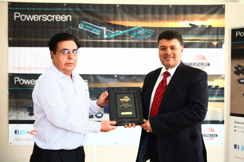 Rajen Khoda, director of sales – Middle East, Powerscreen makes a presentation to Ahmed Rashed, general manager of Genserv.