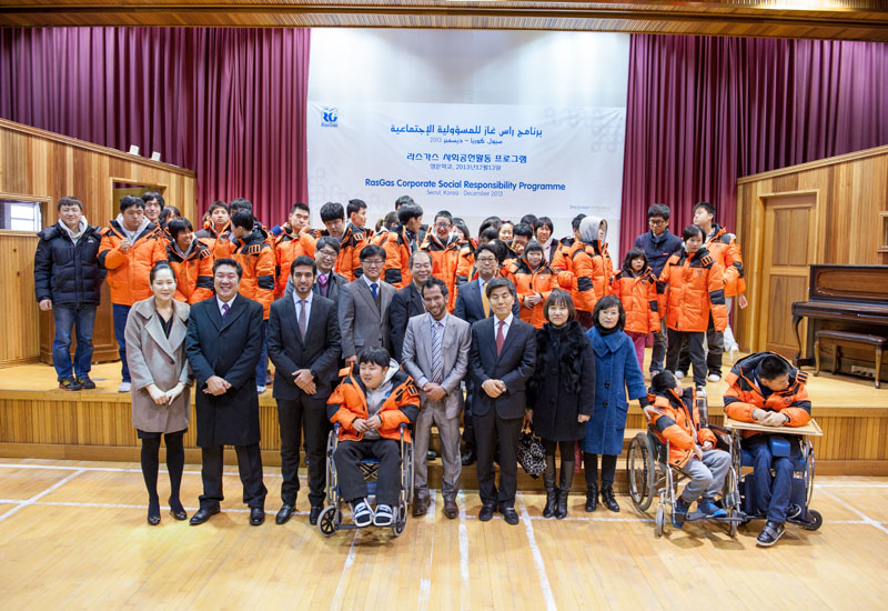 The RasGas team with students and faculty of the school in Seoul, South Korea