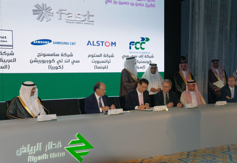 A Samsung representative signs the Letter of Award at the project unveiling ceremony in Riyadh