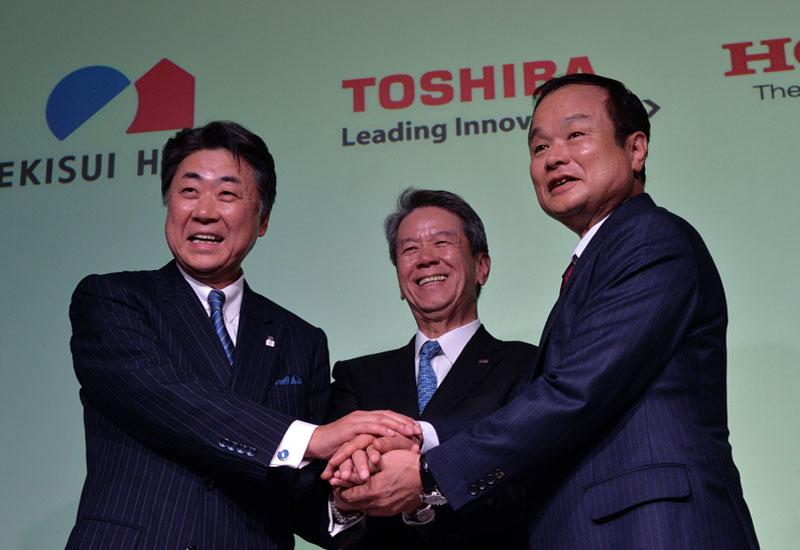L-R: Sekisui House president Toshinori Abe with Toshiba president Hisao Tanaka and Honda Motors'  Takanobu Ito (Photo: Yoshikazu Tsuno/AFP/Getty Image