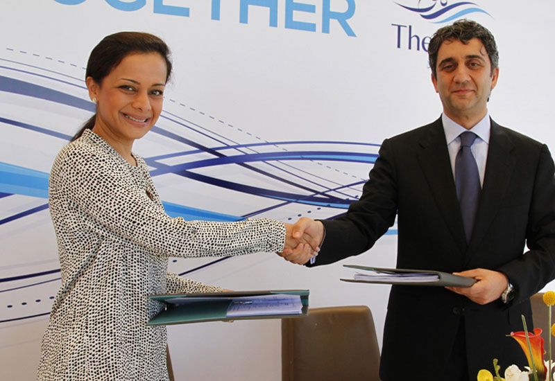 L-R: Al Turki Enterprises executive director Devki Khimji signs the agreement with The Wave, Muscat CEO Hawazen Esber