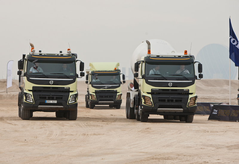 Volvo's latest FMX trucks prepare to take on the specially constructed off-road course.