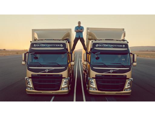 Jean Claude Van Damme between the two Volvo FM trucks