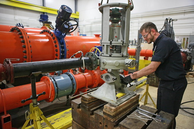 An assembly technician works on Xylem equipment at a production facility.