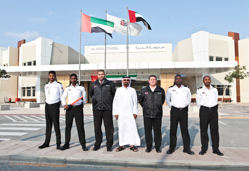 The G4S team: Sultan Al Marzouqi with G4S security personnel at Al Ezzah School in Abu Dhabi.