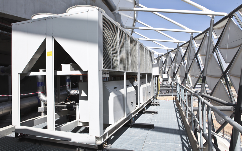 A special steel cantilever had to be designed and constructed to hold two of the stadium's four chillers and maintain the carefully conceived aestheti