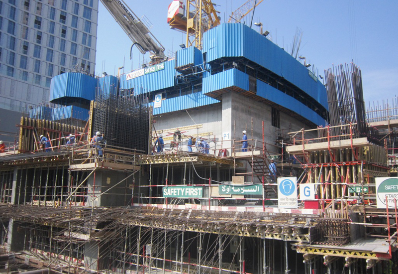 The $138.3m Damac Heights project is being built beside the twisted Cayan Tower in Dubai Marina.