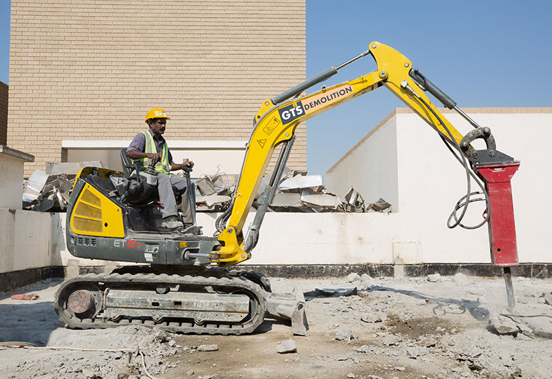 An employee of GTS Demolition gets to work with a Chicago Pneumatic breaker.