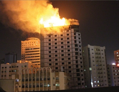 A fire in Sharjah damaged up to three floors of an under-construction high rise. [Image Courtesy: Al Khaleej]