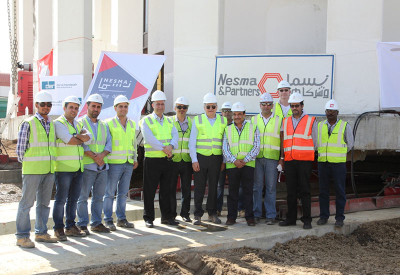 Nesma & Partners CEO Imad Gholmieh (seventh from right) with the project team.