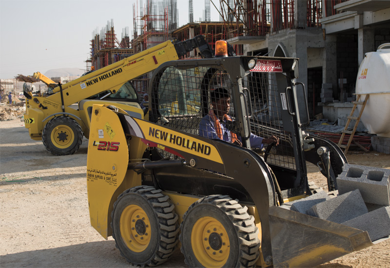 New Holland machines in use on a construction site in Muscat.