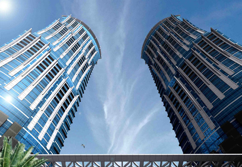 The two towers of the JW Marriott Marquis stand at 355 metres