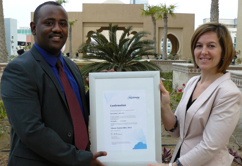 Mohamed Abdelhamied, COO of Quest Qualitas receiving the myclimate certification from Sandrine Le Biavant, Division Manager, Farnek Consulting.