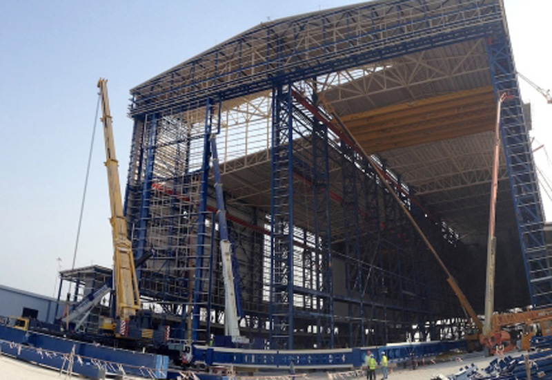 The 68-tonnes doors are the tallest the firm has constructed in its 29-year history.