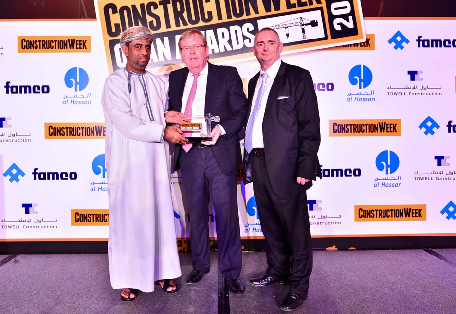 Steve Leith (R) project lead on the Majlis Oman collected the award from Michael Severs of Hill International (C).