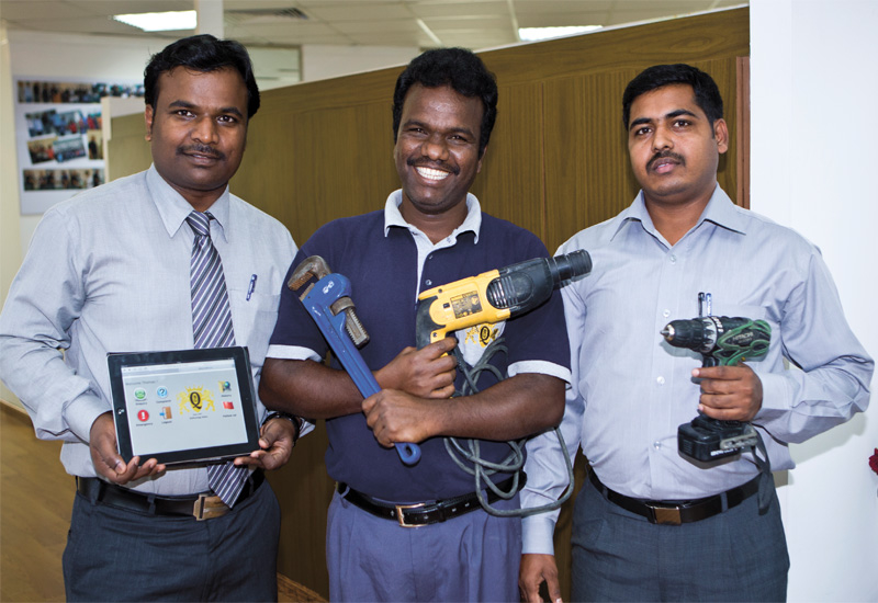 The FM team displays its tools. (L-R) Subramanian, technical services manager; Karrupasamy, technician; and, Javel, supervisor.