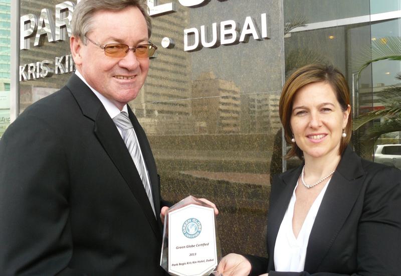 Scott Butcher, general manager of The Park Regis Kris Kin Hotel Dubai, receives the Green Globe Award from Sandrine Le Biavant, division manager, Farn