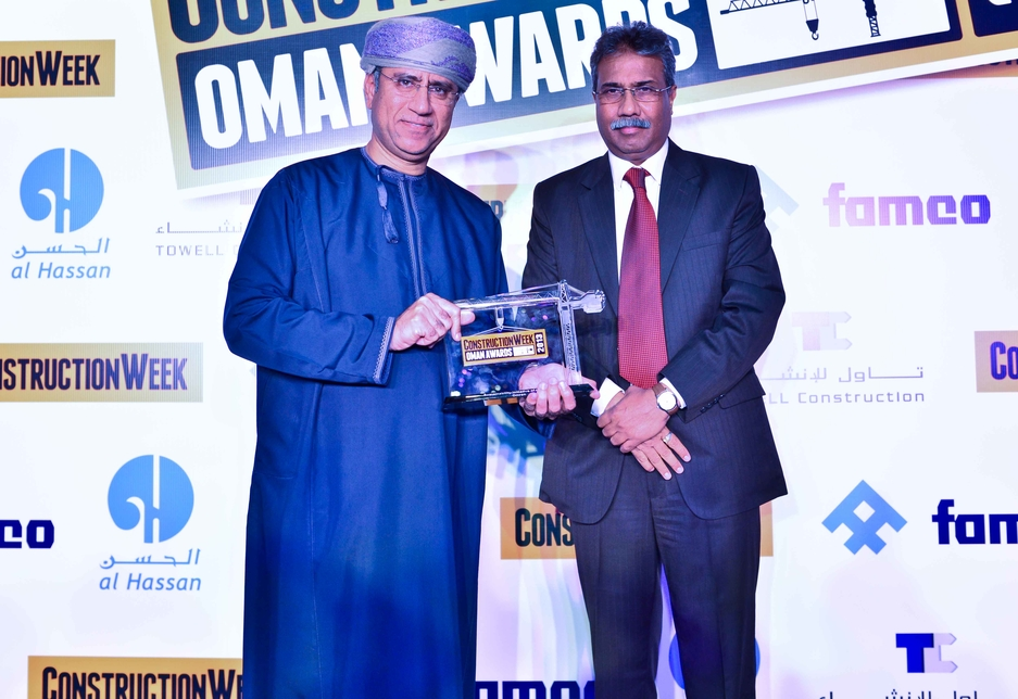 Omran's Abdul Wahid Al Farsi (l) receives  the Sustainable Initiative of the Year Award from Vasanth Kumar, Towell Construction.