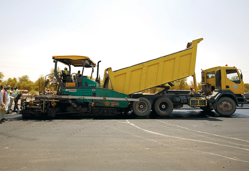 A constant supply of asphalt keeps pavers running.