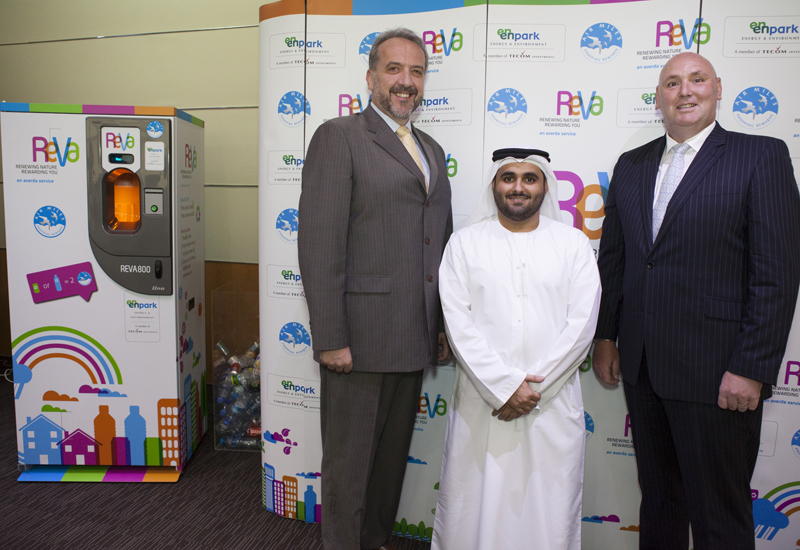 The ReVa machine flanked by Mark Mortimer-Davies, CEO of Air Miles Middle East, Saeed bin Ghubash, director of Enpark, TECOM, and John Irvine, managin