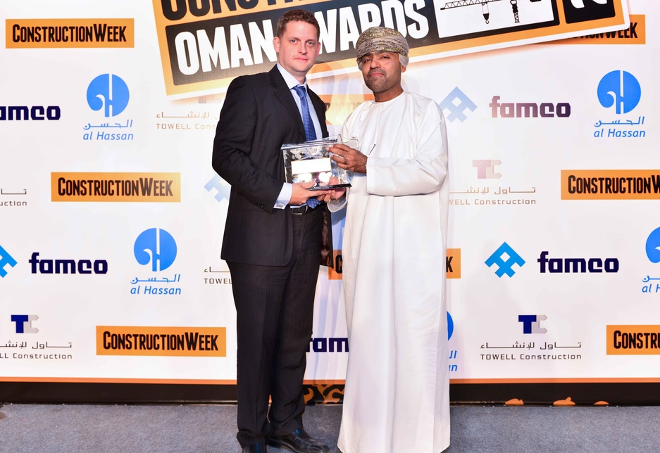 Construction Executive of the Year Matthew Squires (l) receives his award from Hassan Ramadhan Suleiman.