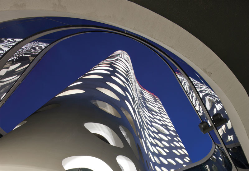 The 41cm-thick concrete facade of  the O14 tower is perforated by 1,000 circular openings.