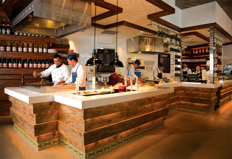 Cooking stations create a market atmosphere.