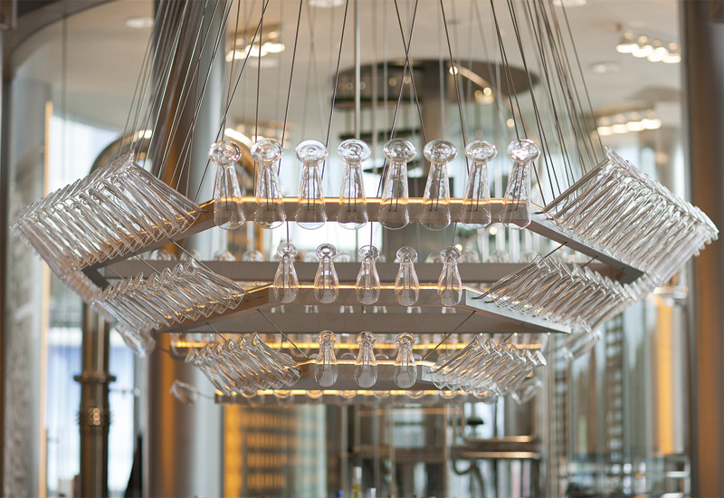 A glass chandelier provides an innovative storage solution.