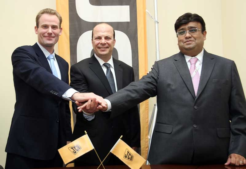 Celebrating the new deal: JCB buyers in the UAE stand to benefit.