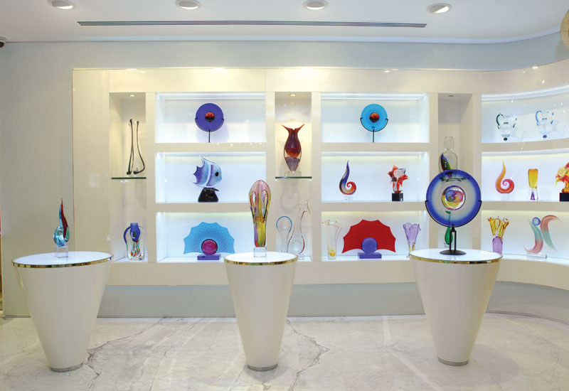 The glass art is displayed in a gallery-like space.