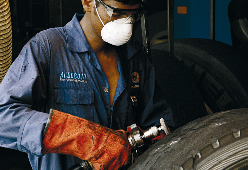 Removing tread impurities and preparing the carcass is a  hands on job.