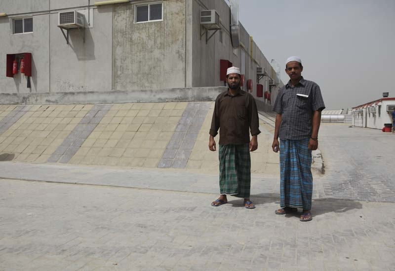 Two workers at the Nad Al Sheba camp.
