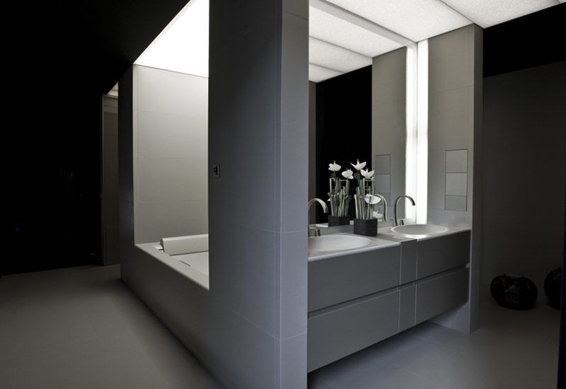 The bathroom is designed to be intimate and elegant
