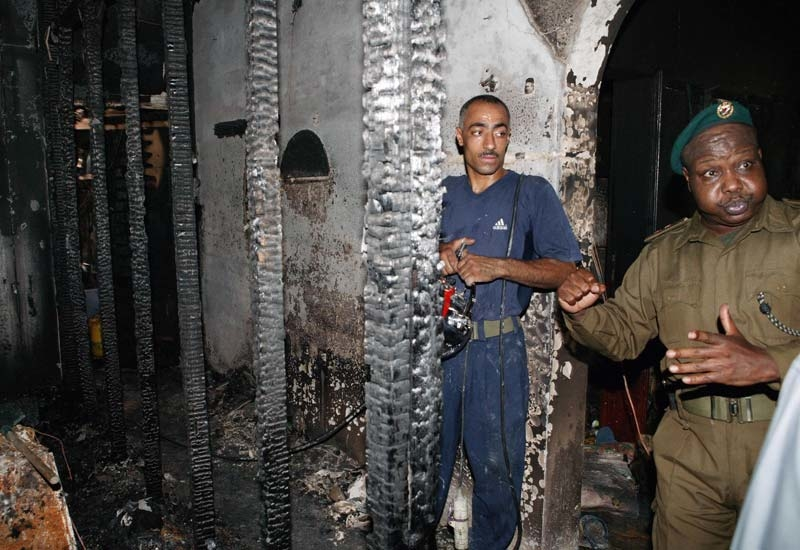 Firemen inspect the building following the blaze on July 30, 2006. (Getty Images)