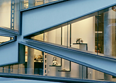 Wedge-shaped glass facade.