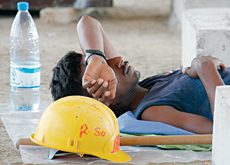As workers rest during the midday break