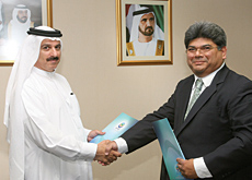EHS CEO Ahmed Abdul Hussain (left) and Pacific Controls Systems CEO Dilip Rahulan.