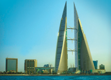 Located in the Manama business district, the Bahrain World Trade Centre comprises two 50-storey mixed-use towers. Three wind turbines are expected to
