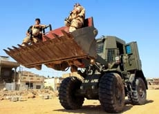 Construction efforts in Iraq face considerable security difficulties.