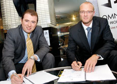 DEAL IS DONE: Mehdi Amjad signs the contract with Graeme Robson of Nasa Multiplex.