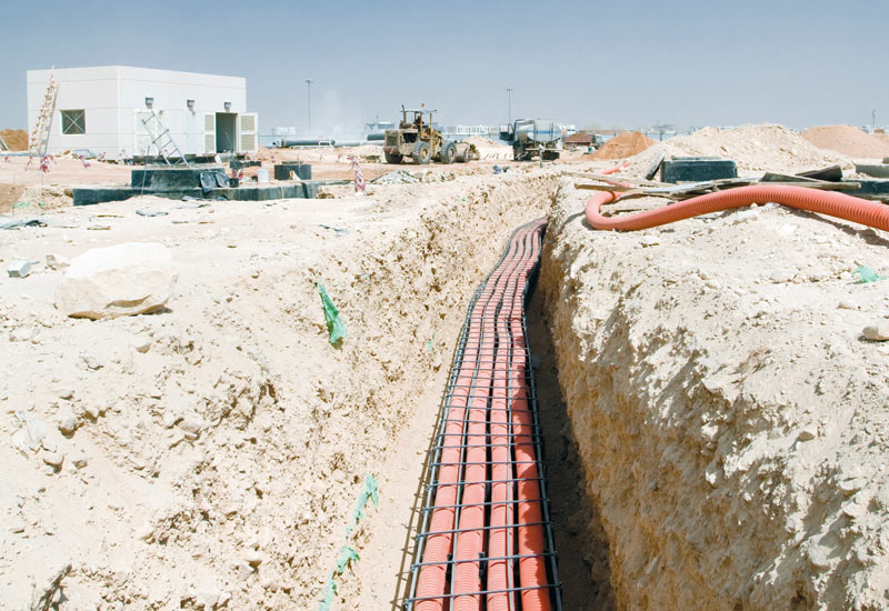 The optic fibre cable is enclosed in a high strength corrugated plastic pipe before being encased in concrete to ensure its longevity.