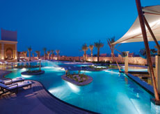 Rounded shapes are popular in completed pools. (Outdoor pool at Banyan Tree Al Areen