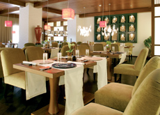Timber is used to create a warm atmosphere in the restaurant.