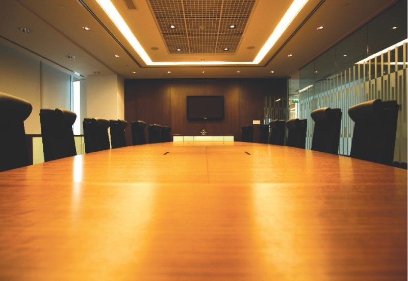 The 16-person boardroom table.